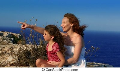Family happy smiling cliff blue sea
