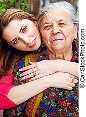 Family - happy young woman and grandmother