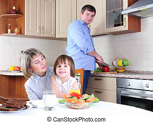 family has breakfast in the kitchen