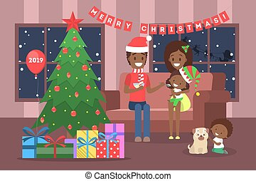 Family have fun together at christmas tree