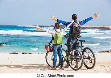 Family having a excursion on their bikes - Back view of girl...