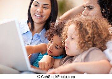 Family having a good time at the laptop together - Young...
