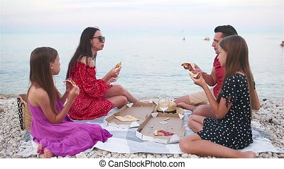Family having a picnic on the beach