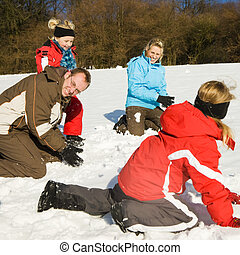 Family having a snowball fight