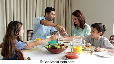 Family having a spaghetti dinner together at home in the...