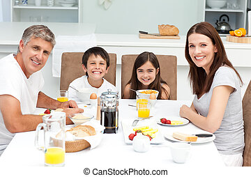 Family habing breakfast in the kitchen at home