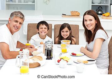 Family having breakfast in the kitc