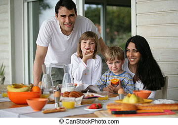 Family having breakfast outdoors