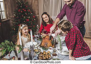 Family having Christmas dinner