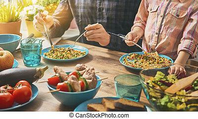 Enjoying family dinner - Family having dinner together ...