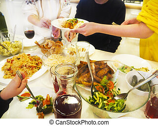 Family having dinner together sitting at the wooden table