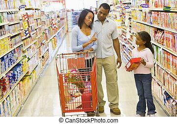 Family having disagreement in supermarket