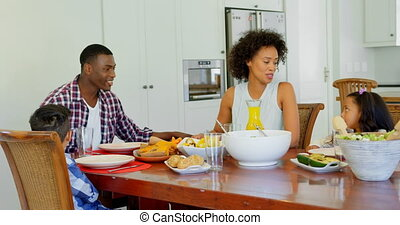Family having food on dining table at home 4k