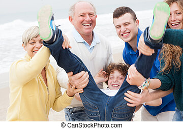 Family having fun at beach