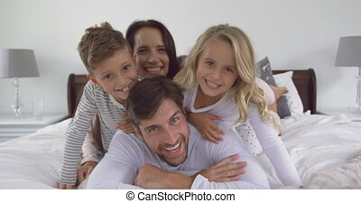 Family having fun in bedroom at home 4k
