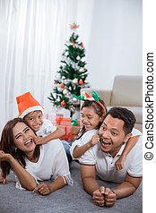 family having fun in christmas day