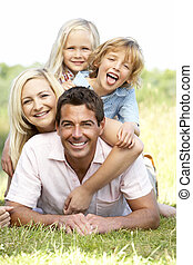 Family having fun in countryside