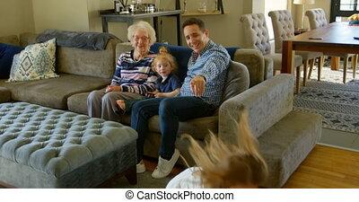 Family having fun in living room at home 4k