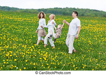 family having fun on a walk in nature