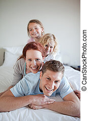 Family having fun on the bed