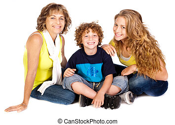 Family having fun on the floor, smiling at camera