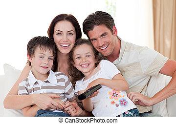 Family having fun on the sofa