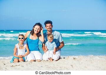 Family having fun on tropical beach