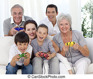 Family having fun playing video games