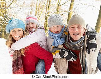 Family Having Fun Snowy Woodland