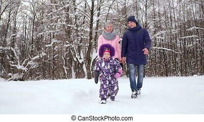 Family Having Fun Snowy Woodland.