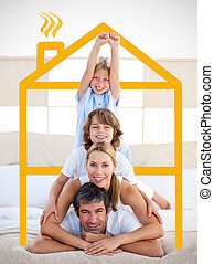 Family having fun with yellow drawing house in the bedroom
