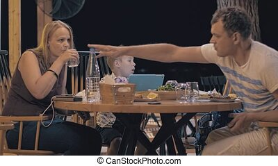 Family having meal in outdoor cafe