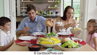 Family having meal together on dinning table at home 4k