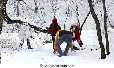 Family Having Snowball Fight