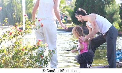 Family having  walk outdoors in summer