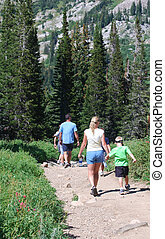 Family Hiking - Family hiking on a mountain trail.