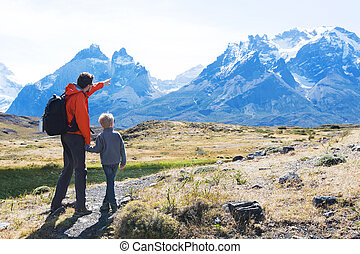 family hiking in patagonia - family of two, father and son,...