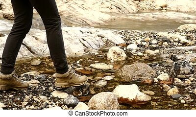 Family hiking near the river in slow motion