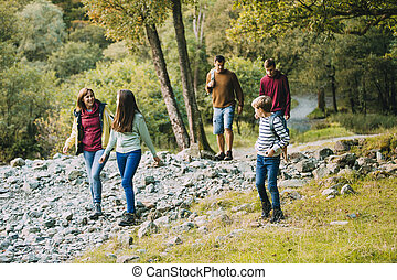 Family are hiking together through the Lake District.