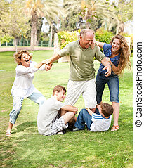 Family holding back grandfather - Family members holding...