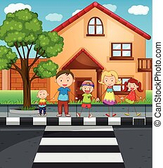 Family holding hands while crossing the road