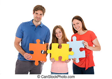 Family Holding Jigsaw Puzzle Pieces