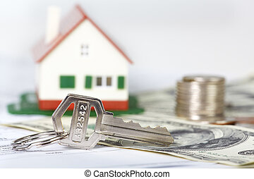 Family house and key. - Family house with money and key....
