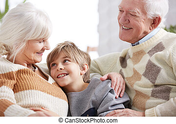Family hug between grandparents
