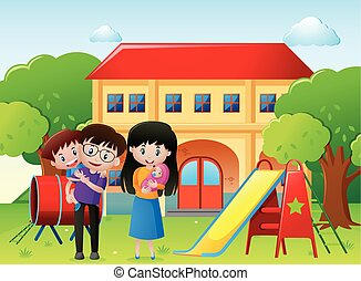 Family in a park with house