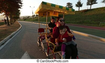 Family in a Pedal Bus 2 - 2) Glidecam video shot of a family...