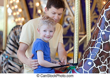 family in amusement park - happy family of two at...