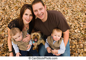 Family in autumn - Young family with twin boys and pet dog...