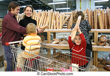 family in bread shop