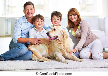 Family in casual - Restful family members and Labrador...